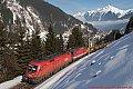 Foto zeigt: Blick von oben auf Güterzug gezogen von 1116.040 und 1144.212 bei Böckstein