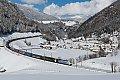 Foto zeigt: Helles und dunkles Zebra im Schnee: LoMo 185.661 + 189.927 mit TEC bei St. Jodok am Brenner
