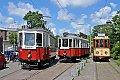 Foto zeigt: Viel Betrieb mit historischen Straßenbahnen in Amsterdam