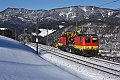 Foto zeigt: Bahndienstfahrzeug X552.104 auf verschneiter Apfelwiese (Semmeringbahn)