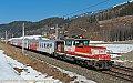 Foto zeigt: 1163.015 mit drei CS-Wagen bei Weissenstein-Kellerberg (Tauernachse)