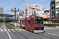 Foto zeigt: Straßenbahnen in Japan: Mittelaltes