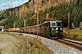 Foto zeigt: Grüne 1110.28 mit Güterzug bei Bischofshofen (Giselabahn 1983)